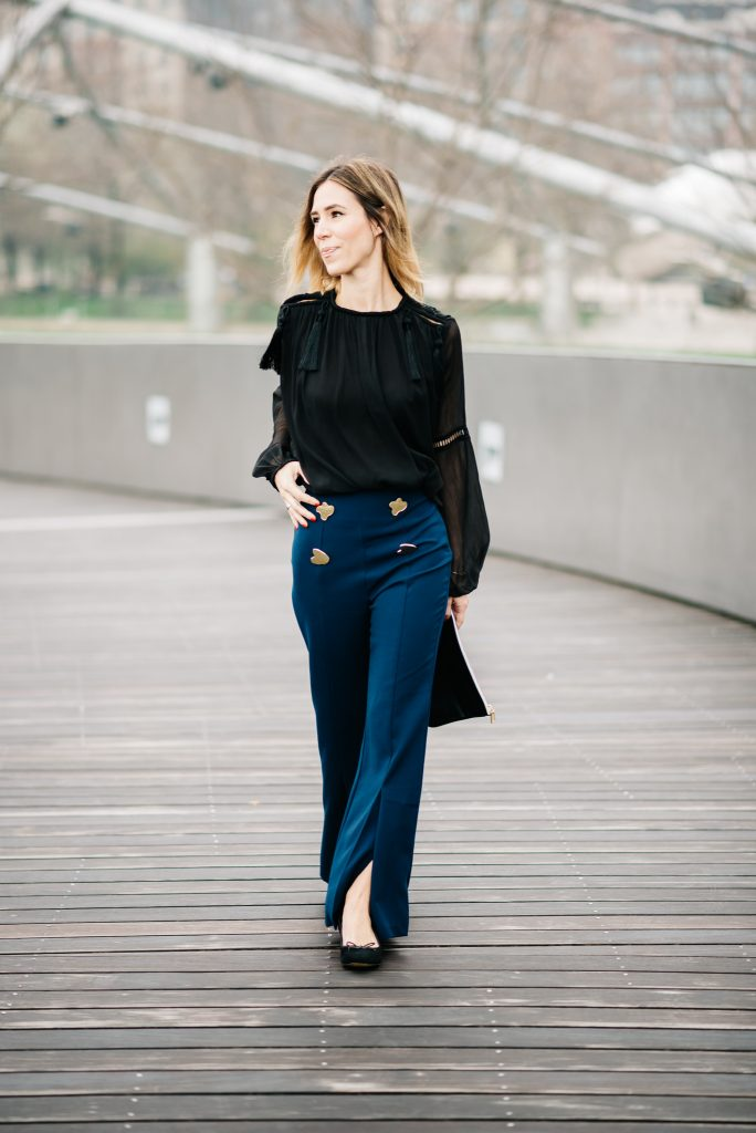 Storets Goldie Slash Out Pants, Charlotte Olympia Kitty Flats, H&M Tassel Blouse, Monogrammed Leather Pouch, Chicago Blogger, Sports and Fashion Blogger