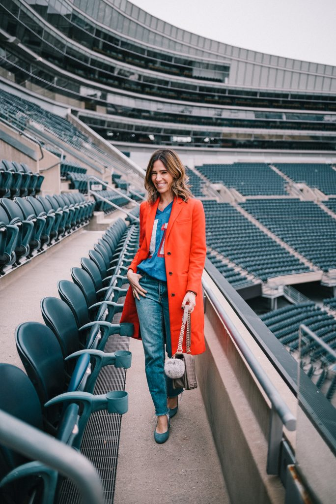 Blogger Mary Krosnjar wearing red Jcrew wool coat and vintage New England Patriots jersey