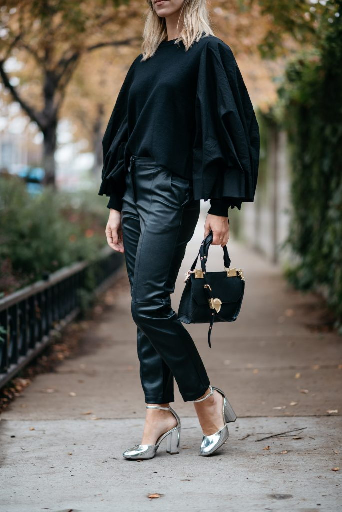 Blogger Mary Krosnjar wearing HM Knit Sweater with balloon sleeves styled with faux leather pants