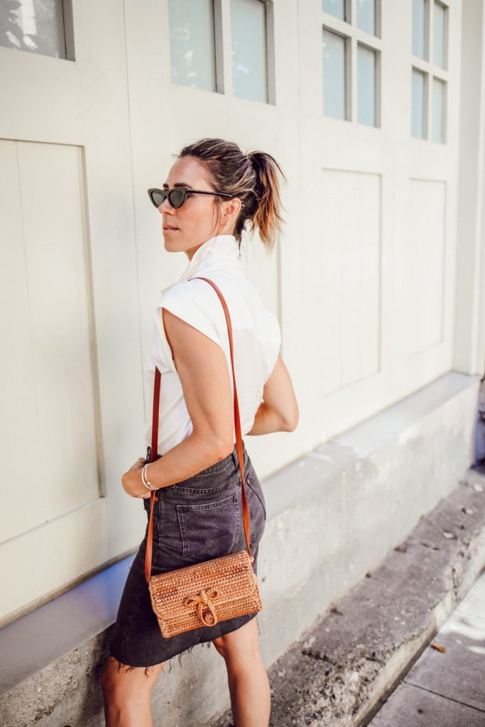 Blogger Mary Krosnjar wearing H&M white blouse and wicker bag