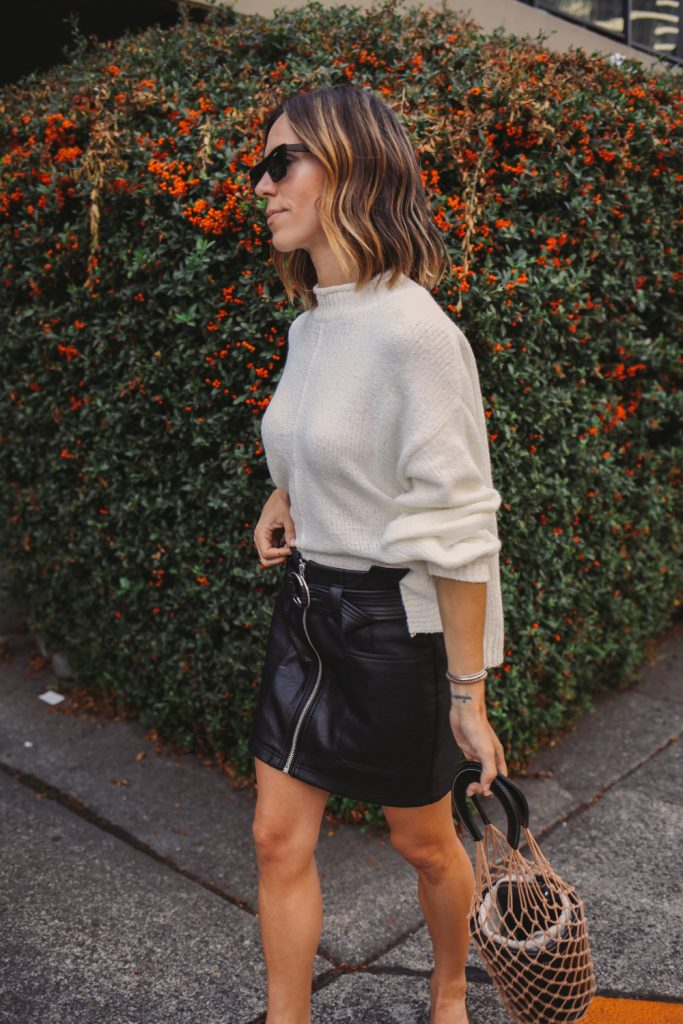 Blogger Mary Krosnjar wearing Topshop Faux Leather skirt and Balloon Sleeve Sweater