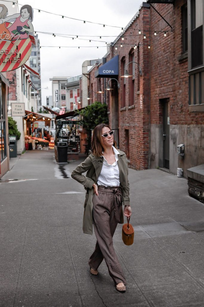 Blogger Mary Krosnjar wearing Point Sur paperbag pant in stripe and Who What Wear Tube Crossbody Bag