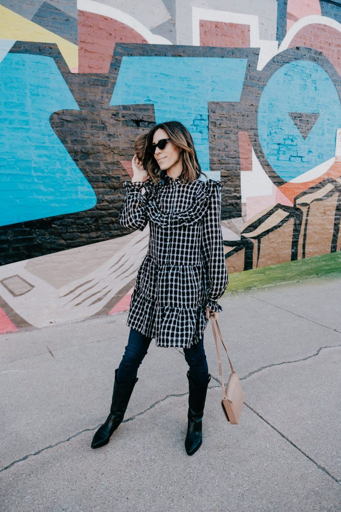 Seattle Fashion Blogger Sportsanista sharing how to wear a dress over jeans and western styled boots