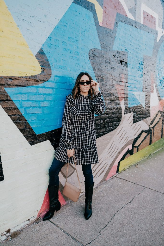 Seattle Fashion Blogger sharing how to style a dress over jeans and western style boots
