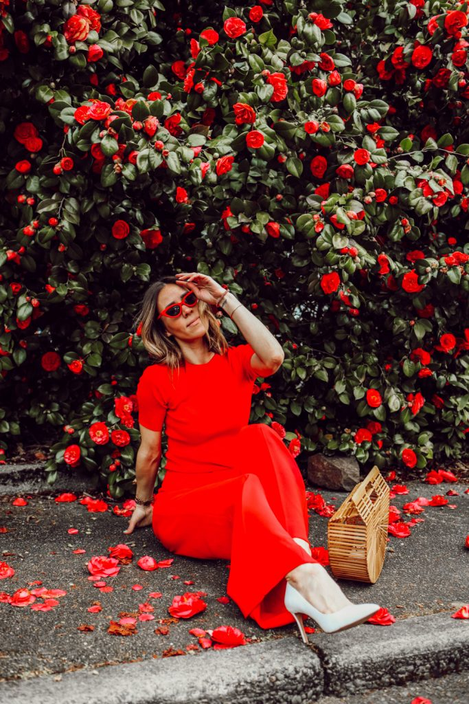 Seattle Fashion Blogger Sportsanista wearing red ribbed shirt, red wide leg pants and white pumps