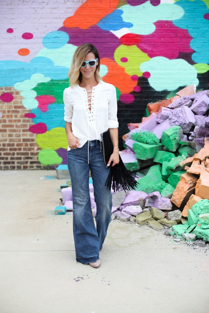 Nasty Gal Lace up Blouse, Flare denim, Vince Camuto Mushroom taupe booties, & Other Stories Sunglasses, Fringe clutch, Center for lost Art, Chicago street art, 70's fashion, 70's inspired fashion