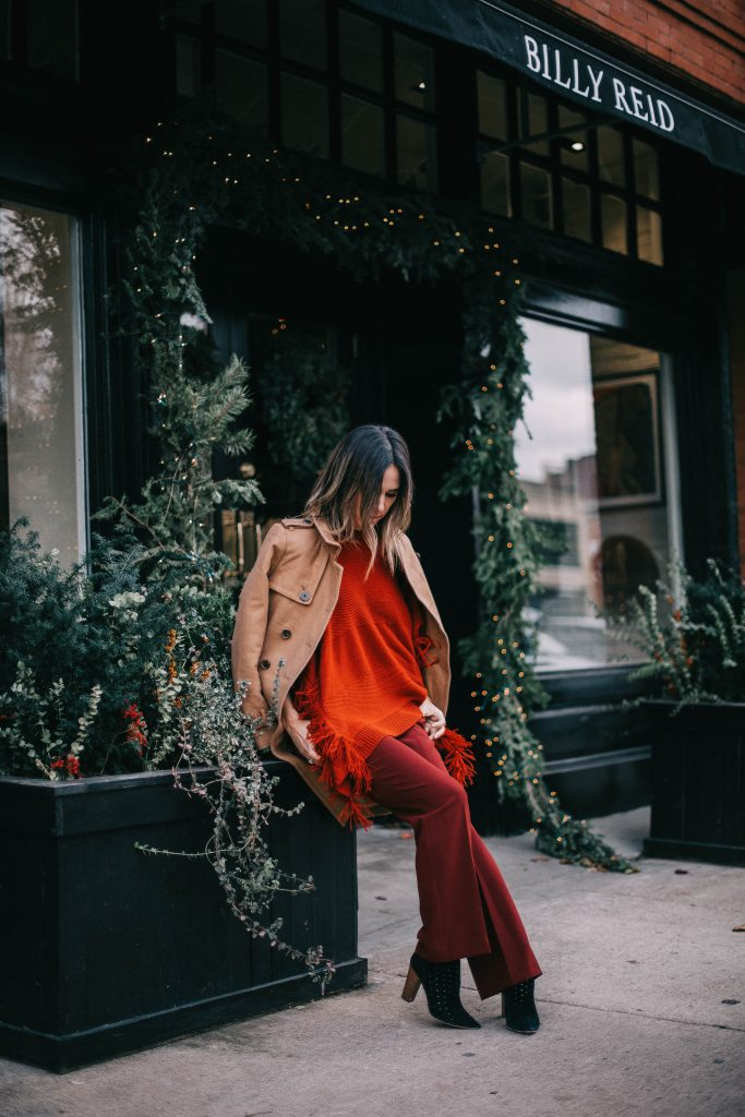 Monochromatic look and red fringed poncho