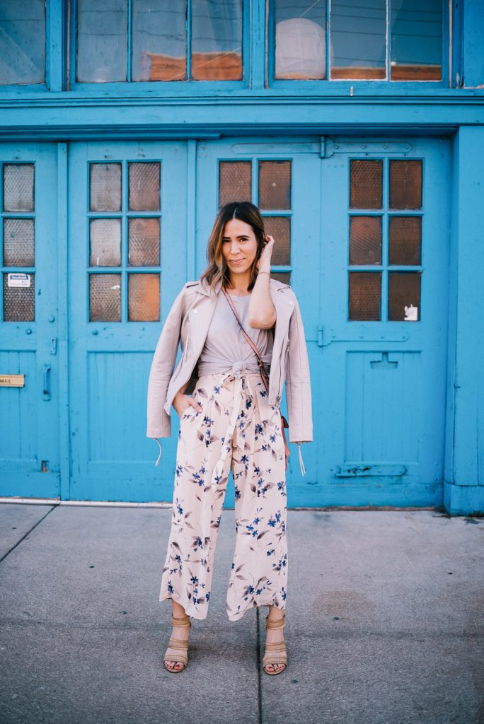 Blogger Mary Krosnjar wearing Floral Jumpsuit from Marshalls and Grey Blank NYC leather moto