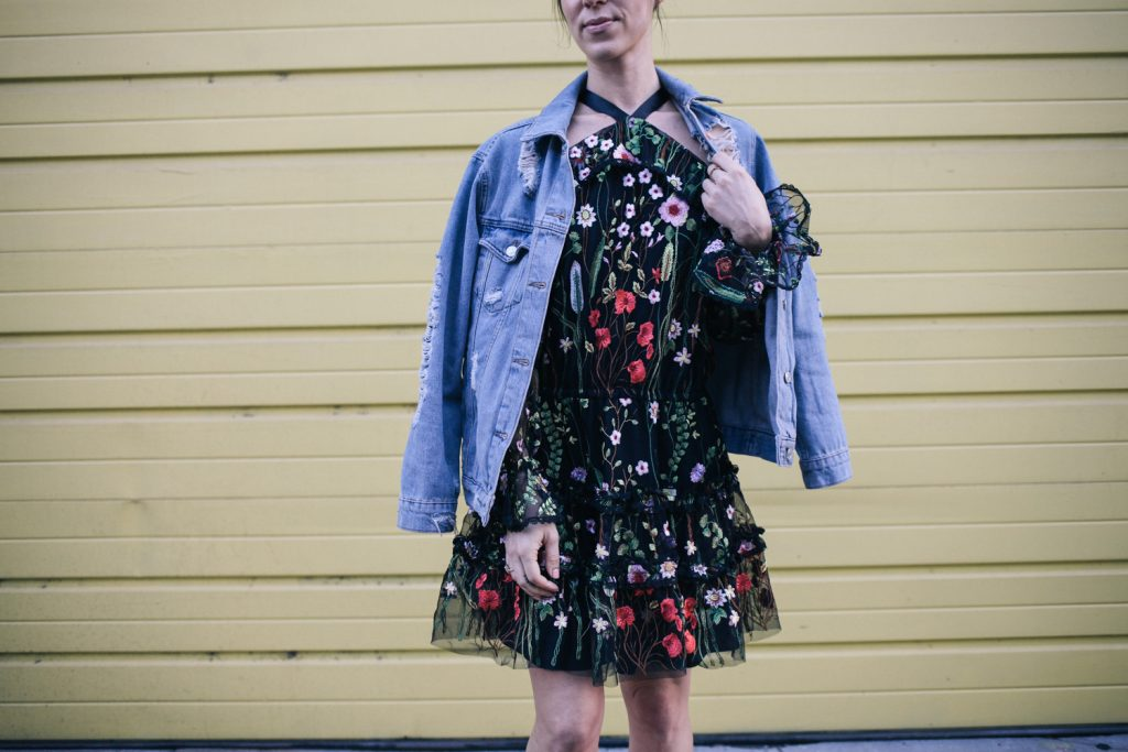 Blogger Mary Krosnjar wearing Black Floral Dress from Rent the Runway and Topshop Distressed denim jacket