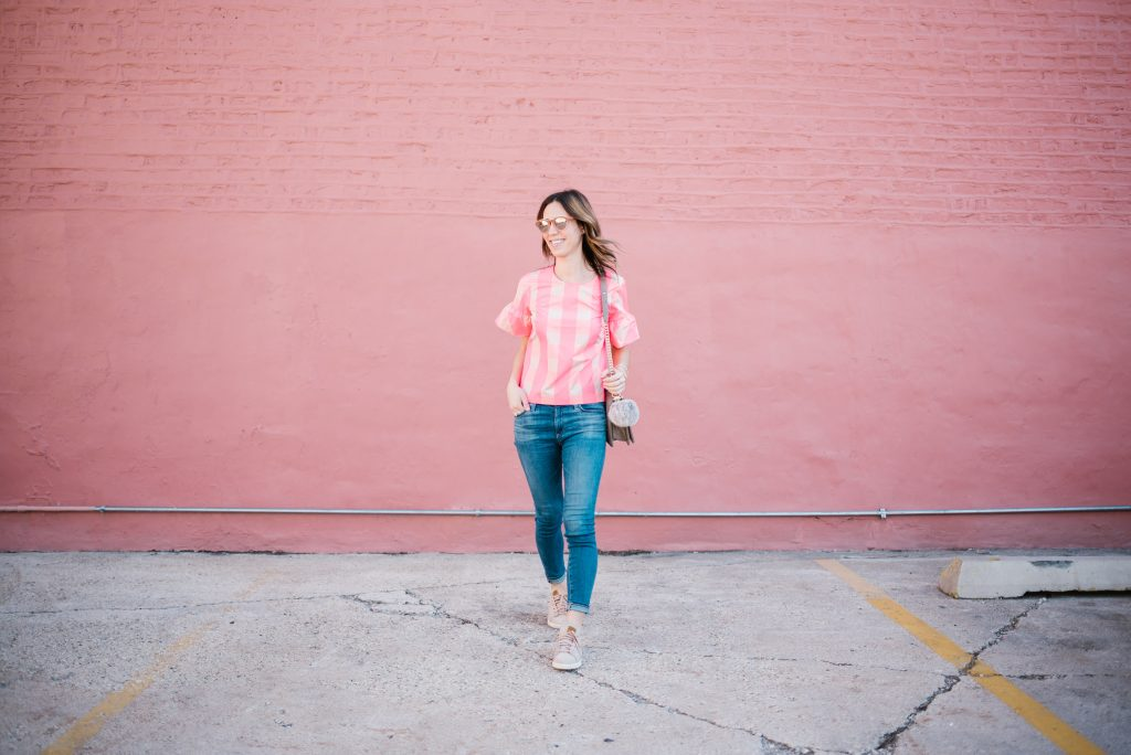 Blogger Mary Krosnjar wearing neon buffalo check JCrew top and AG Jeans