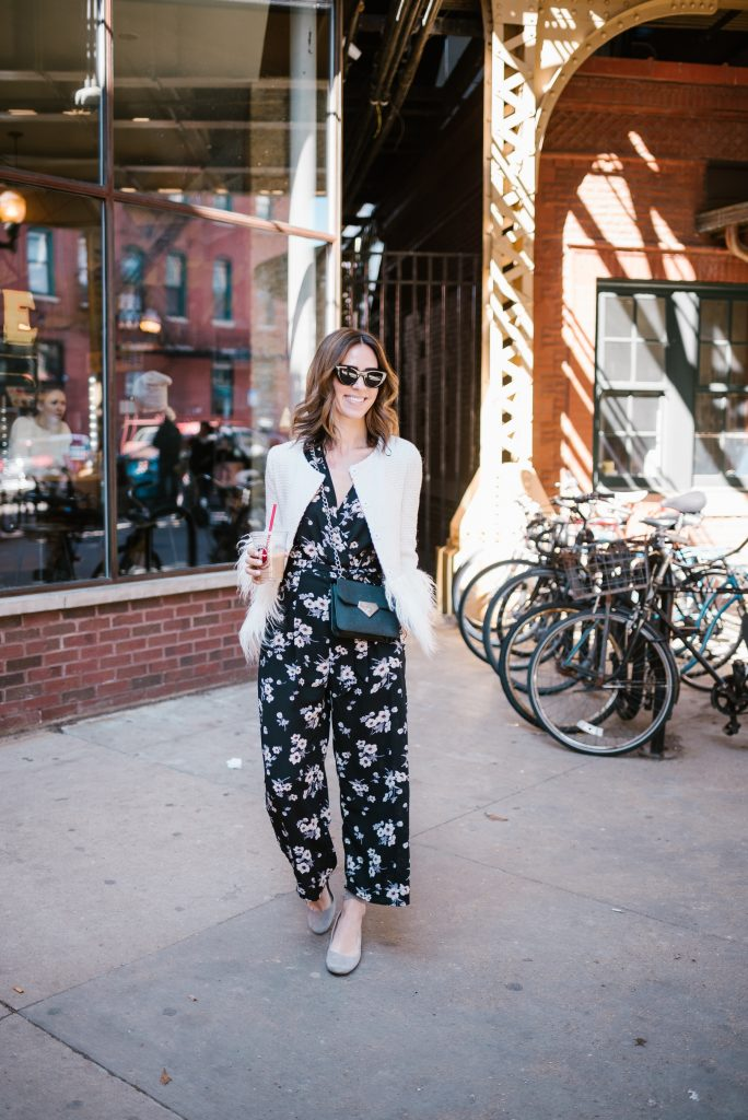 Blogger Mary Krosnjar wearing white blazer with faux fur trim and La Colombe Chicago