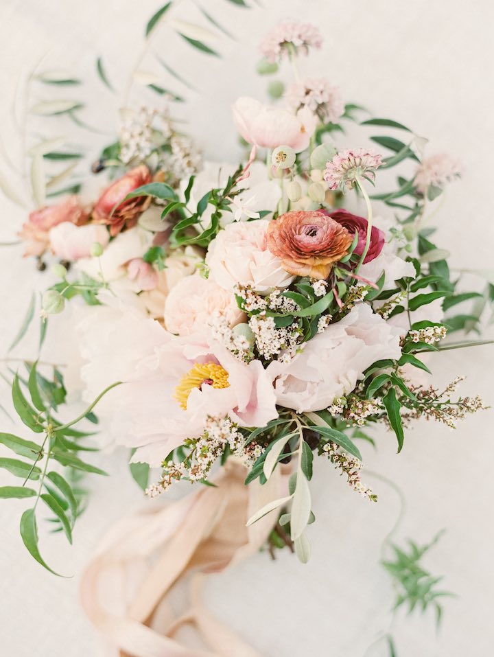 Neutral wedding floral arrangement and Wedding Guest Etiquette