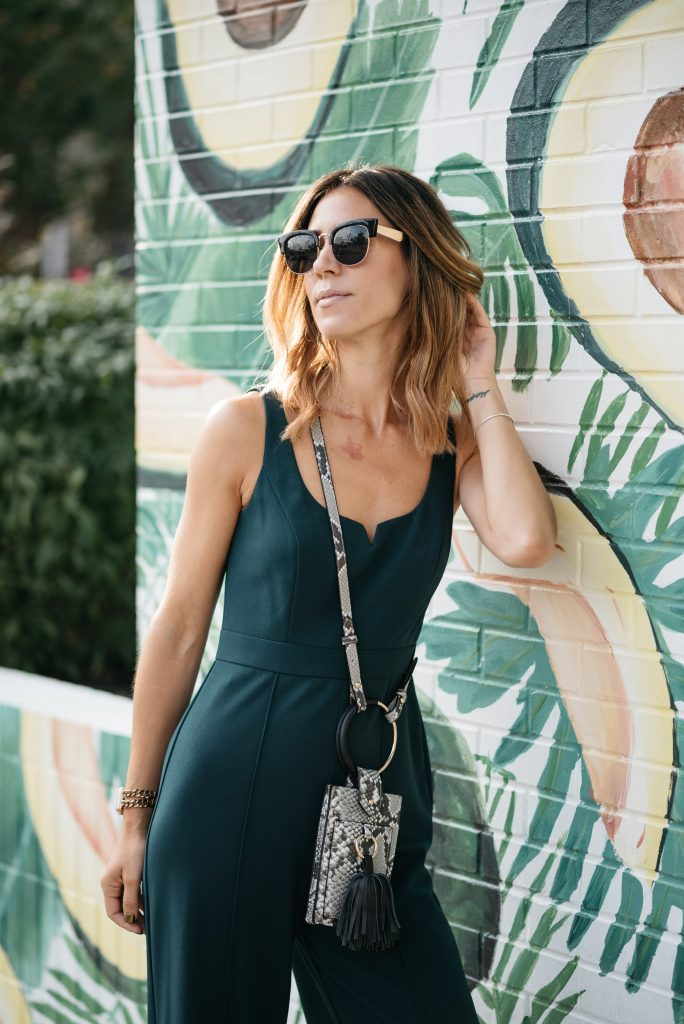 Blogger Mary Krosnjar wearing Free People Retro Sunglasses and Donna Morgan Sweetheart Neck Jumpsuit