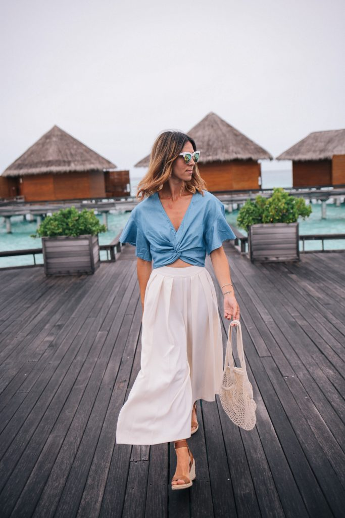 Blogger Mary Krosnjar wearing ASOS wide leg pant with Chambray crop top