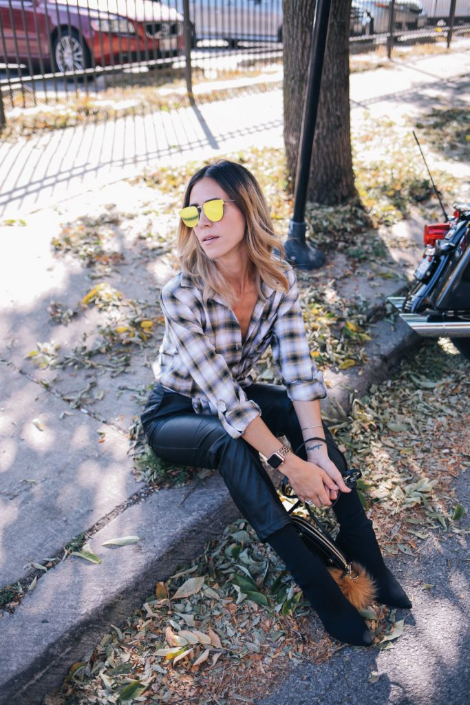 Blogger Mary Krosnjar wearing Purdue Boilermaker plaid flannel and H&M faux leather pants