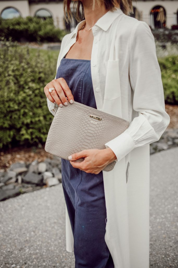 Blogger Mary Krosnjar wearing GiGi New York Monogrammed Clutch