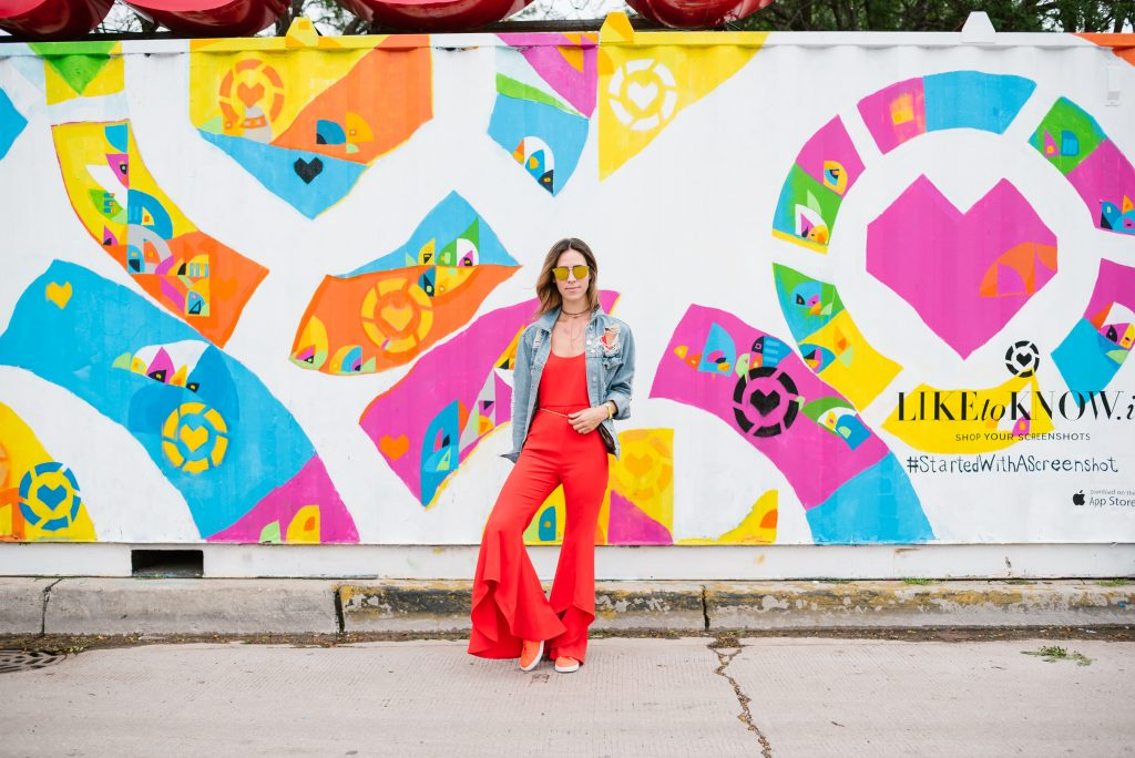 Blogger Mary Krosnjar wearing Red Flare Leg Jumpsuit and Levi's Oversized denim jacket