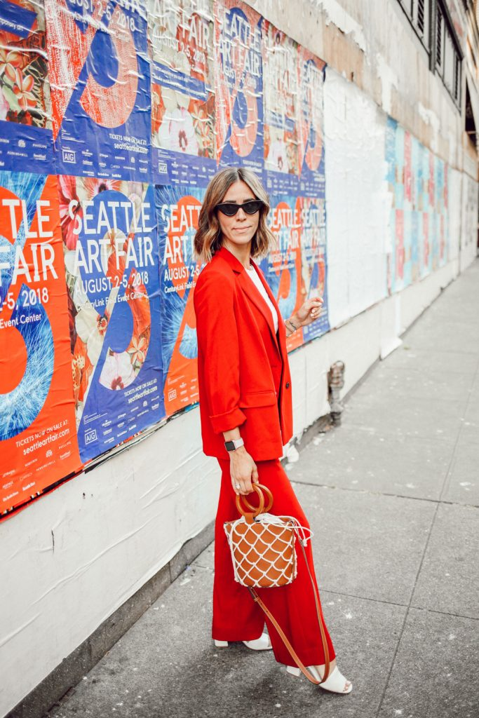 Blogger Mary Krosnjar wearing Topshop Slouch Suit Trousers and Mango Net Bag