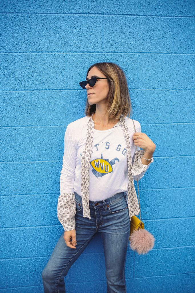 Blogger Mary Krosnjar wearing H&M printed blouse with ties and Madewell Cali Demi Boot