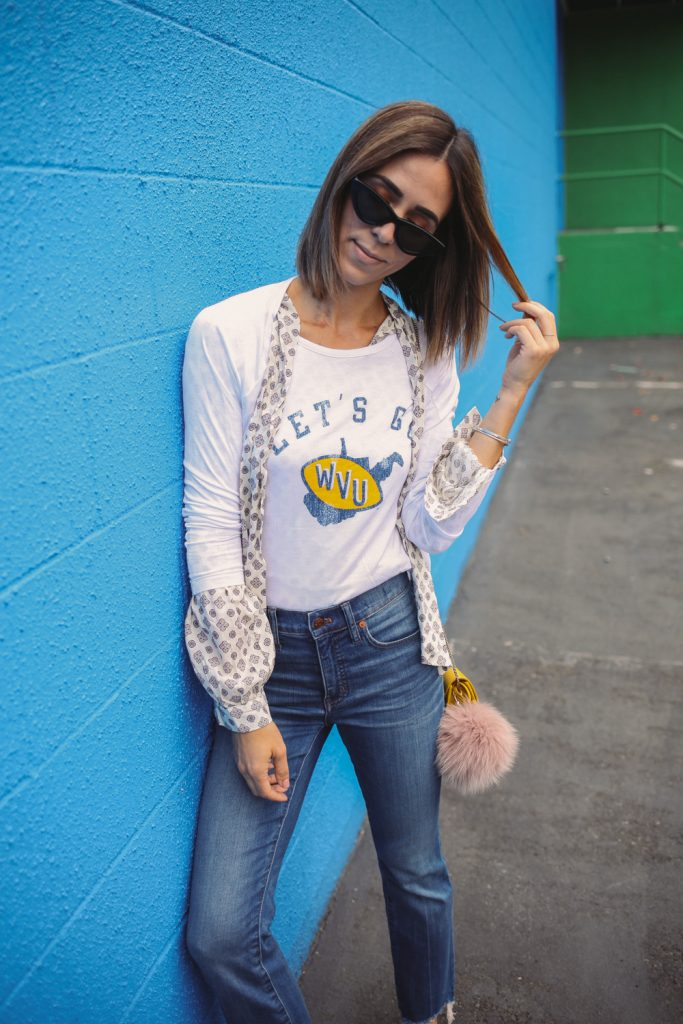 Blogger Mary Krosnjar wearing H&M Patterned Blouse with Ties and Madewell Cali Demi Boot Jeans