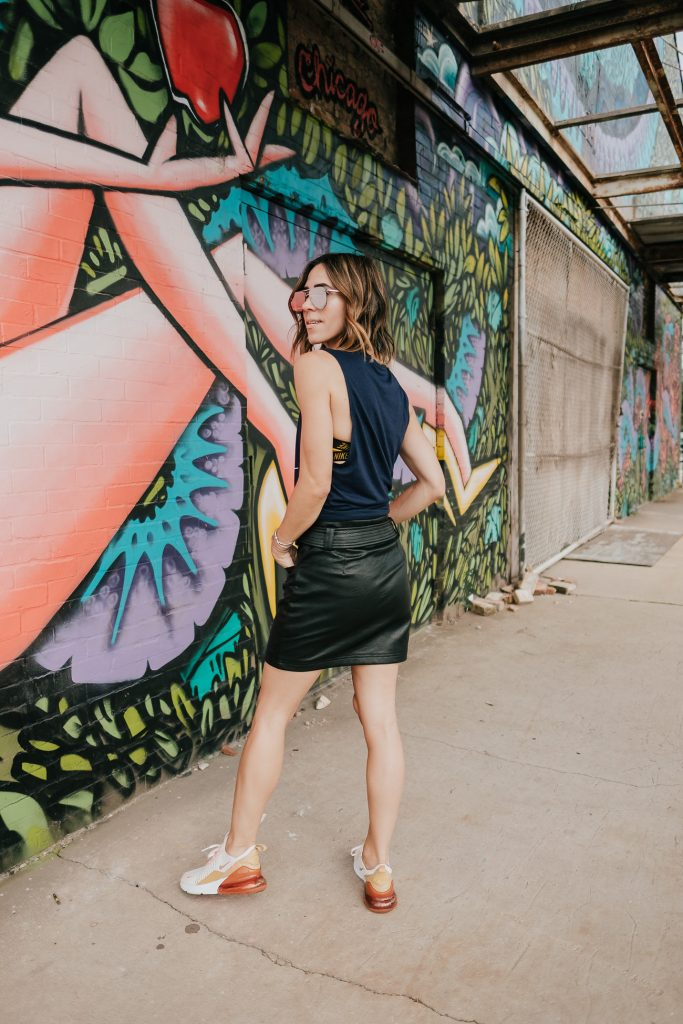 Blogger Mary Krosnjar wearing Topshop Faux Leather Mini skirt and WVU muscle tank