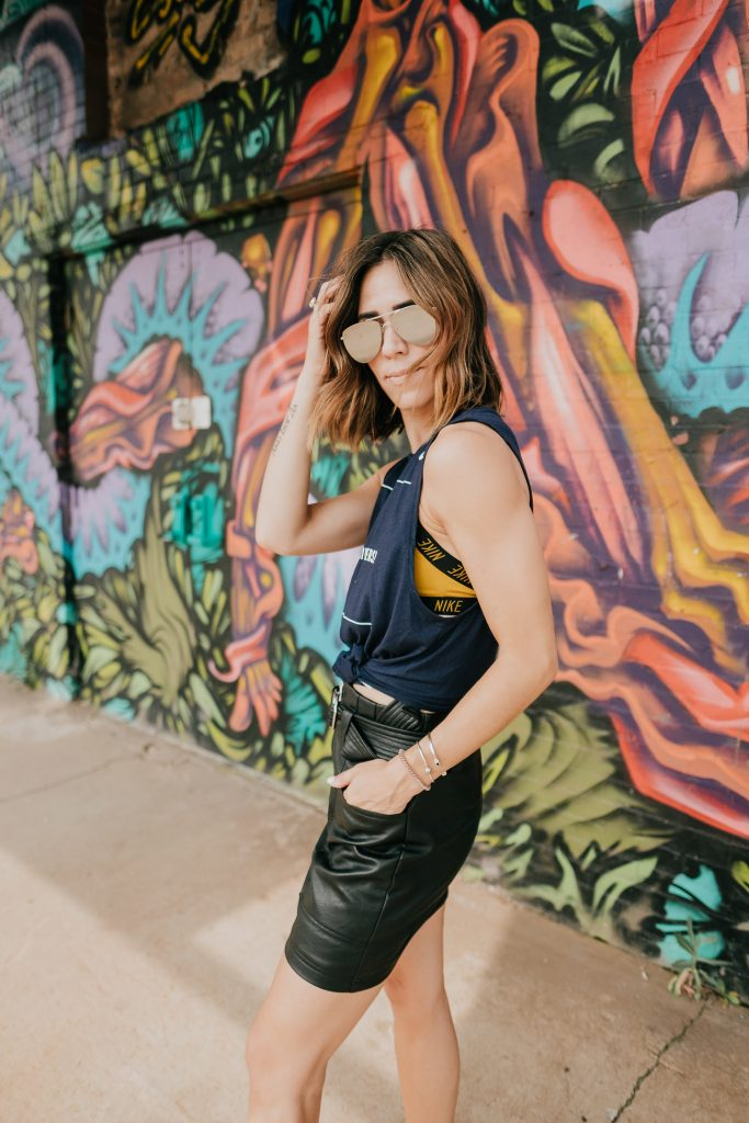 Blogger Mary Krosnjar wearing WVU muscle Tank and Le Specs Mirrored Sunglasses