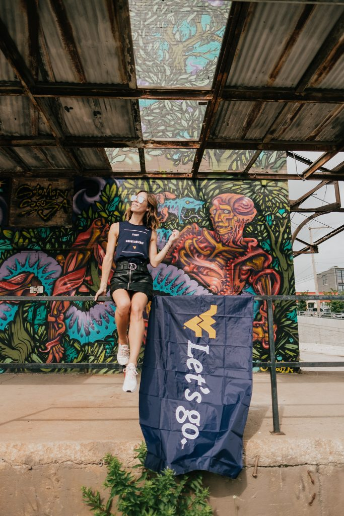 Blogger Mary Krosnjar wearing WVU Muscle Tank and Game Day Fashion