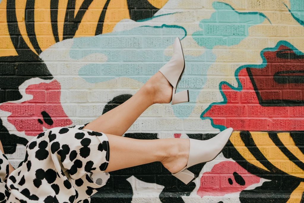 Blogger Mary Krosnjar wearing Who What Wear Polka Dot Sleeveless Ruffle Dress and AGL Mules