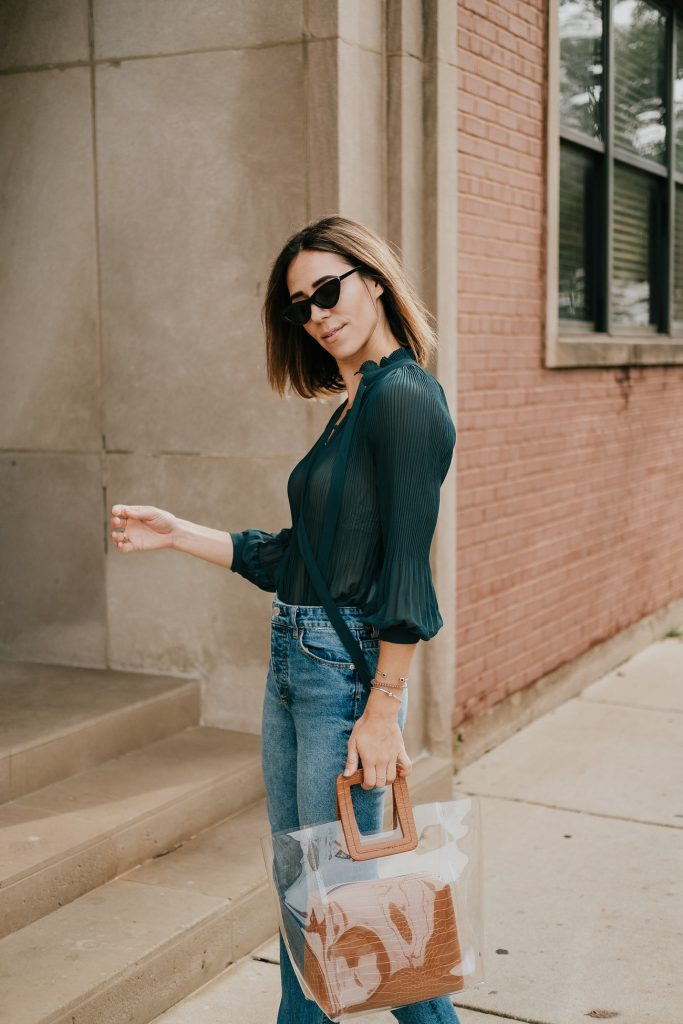 Blogger Mary Krosnjar wearing Neck Tie Bodysuit and Clear Bag