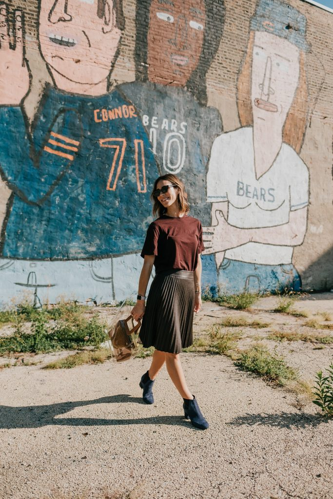 Blogger Mary Krosnjar wearing Naturalizer Navy Suede Booties and Brown Pleated Midi Skirt
