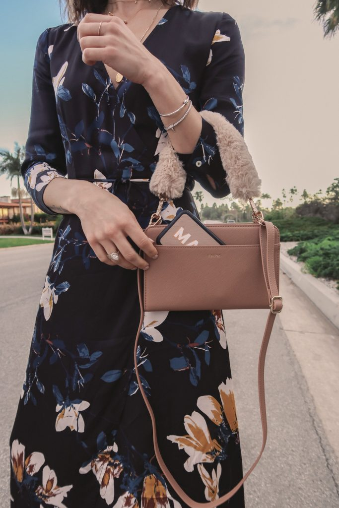 Seattle Blogger wearing Mediterranean Floral Wrap Dress from Shop Emry and CalPak Travel Wallet