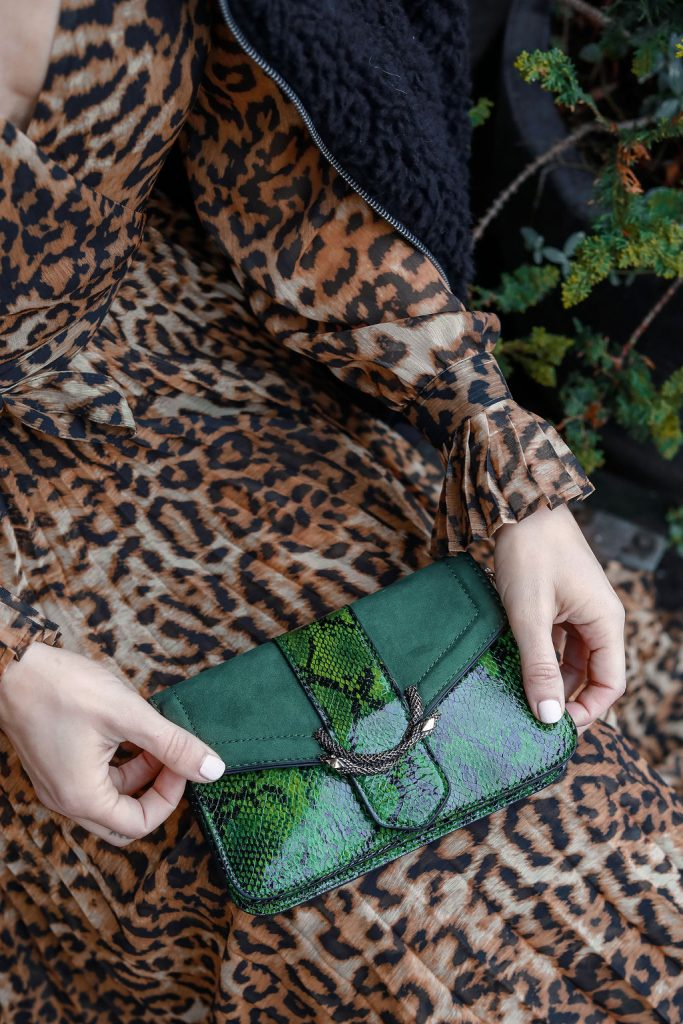 Blogger Sportsanista wearing Topshop Sela Crossbody Bag and H&M Leopard Print Dress