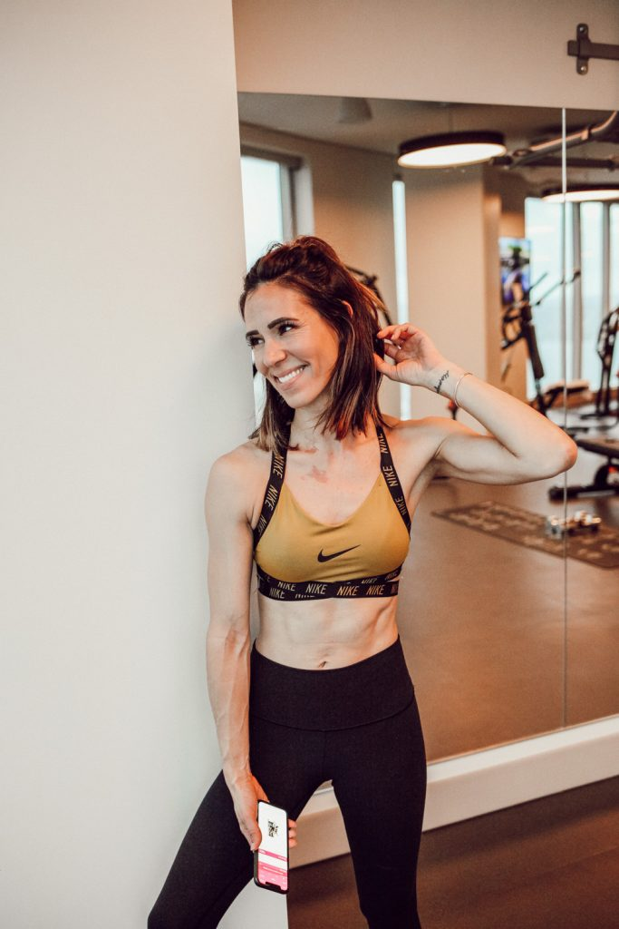 Blogger Sportsnista wearing Nike Indy Logo Women's Light Support Sports Bra and Nike Sculpt Women's Training Crops