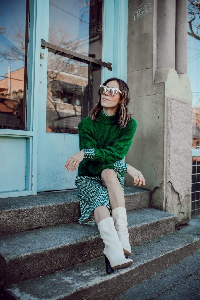 Blogger Sportsanista wearing Dolce Vita Elan Midi Calf Boot and H&M Green Cable Knit Sweater
