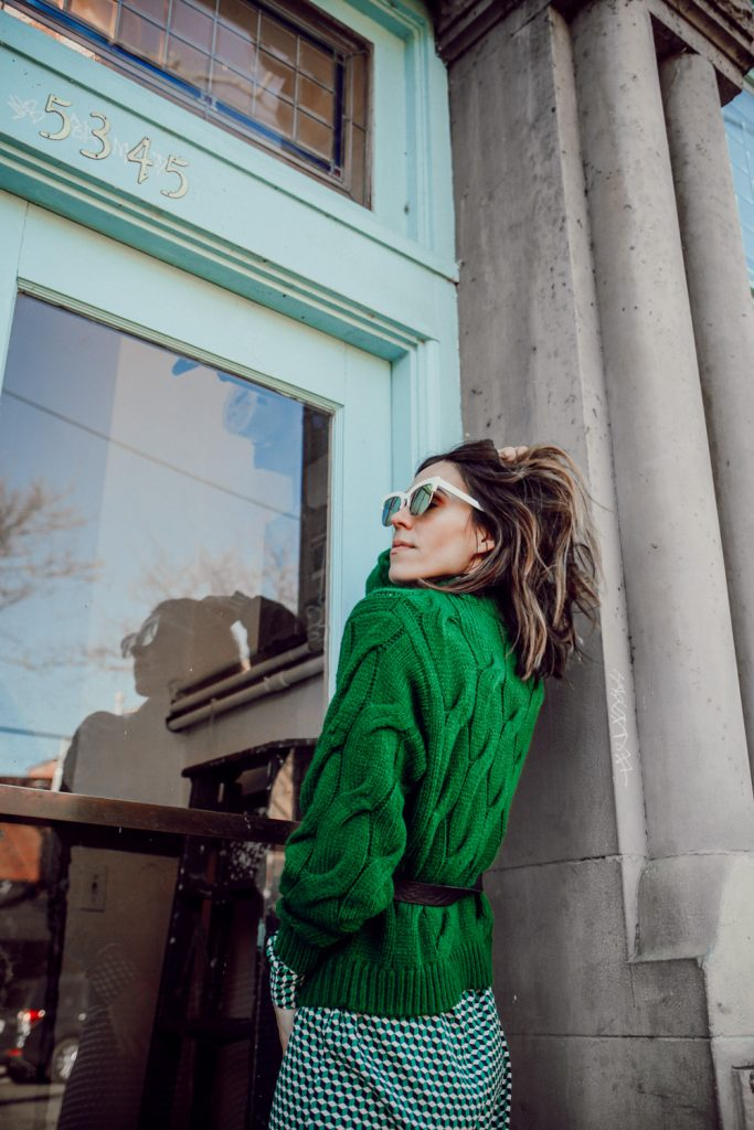 Blogger Sportsanista wearing Green Cable Knit Sweater and White Retro Sunglasses