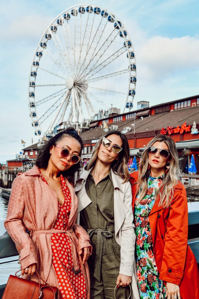 E for Elisa, The Grey Edit and Sportsanista wearing trench coats at the Seattle Great Wheel