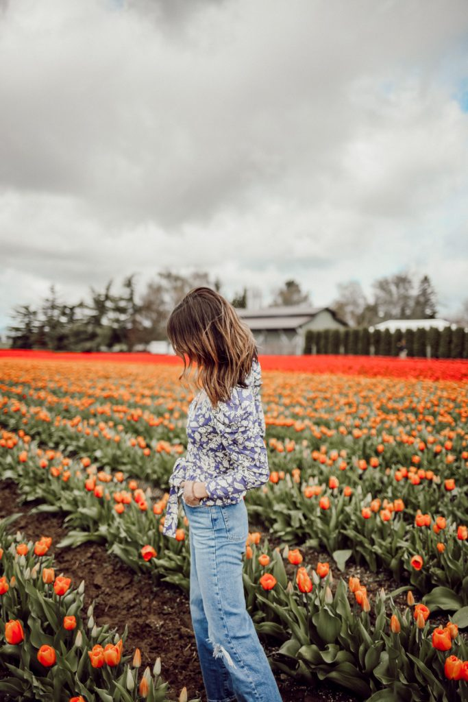 Seattle Fashion Blogger wearing ASTR the Label Puff Sleeve Floral Wrap Top and Levi's Ribcage Jeans