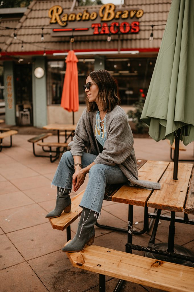 Blogger Sportsanista wearing Topshop Long Cardigan, Levi's Ribcage Kick Crop Denim and Sam Edelman Suede Slouchy Boots