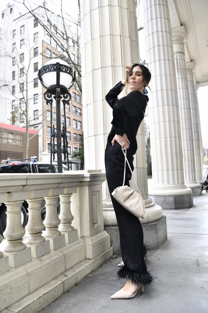 Blogger Sportsanista wearing sleeper silk pajamas with ostrich feather trim