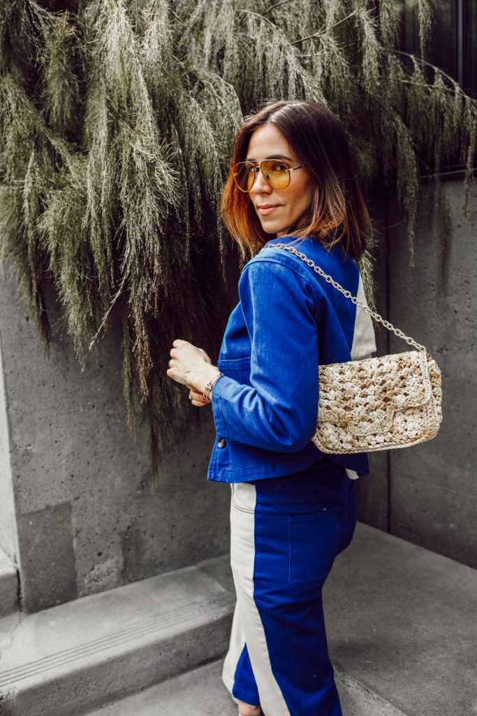 Seattle Blogger Sportsanista wearing cropped denim jacket and woven bag for spring look