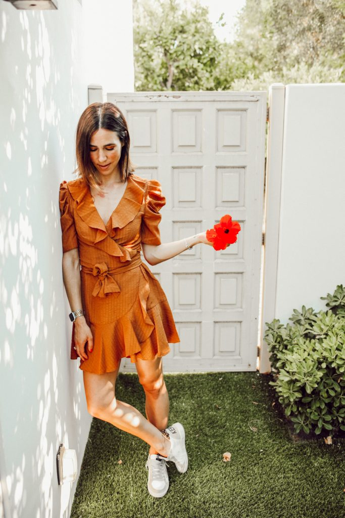 Blogger Sportsanista wearing Ruffle Trim Mini Dress and Golden Goose Sneakers