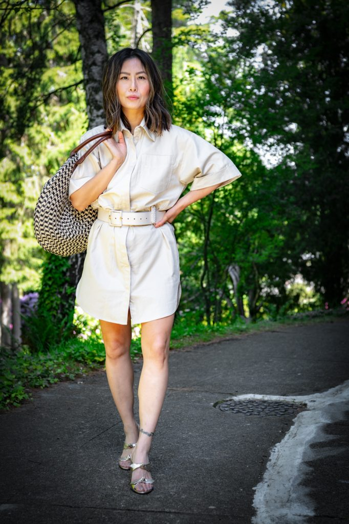 Blogger E for Elisa wearing utility summer dress and gold sandals