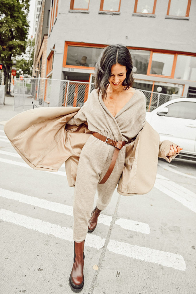 Blogger Mary krosnjar wearing sskein wrap collar jumpsuit with lug boots and oversized blazer